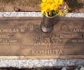 A TRIBUTE TO MR. & MRS. KOSHUTA PLACED ON A GRANITE FOUNDATION